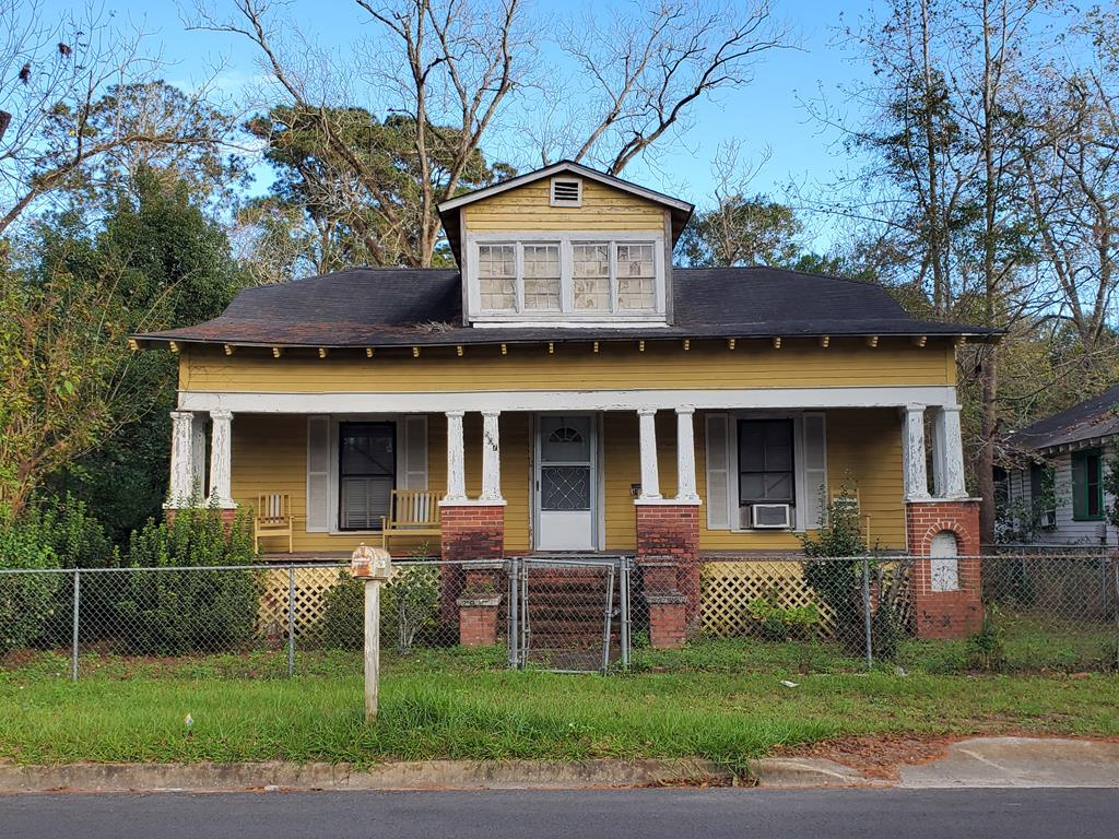 Investors, check out this 3 bedroom house with big possibilities for resale or rental. Large front porch and  fenced in yard with storage building in the back.  Sold as-is