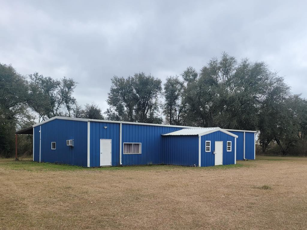 Great business location on Hwy 91 with very good visibility.  Conveniently located to Bainbridge area. Lots of road frontage.   This Large warehouse has single phase and triple phase electric panels, 14 foot walls with lots of lighting and two large fans . Large roll up door, allows for ease of loading.  There is a 256 sq ft front office and living quarters on one side of the building.   Lots of storage in warehouse above living quarters.  Along the back side of the building is a large carport almost the full length of the building, with rear door for accessibility.  The living quarters has a new AC unit and new luxury vinyl tile on floor throughout.  This price includes additional 9 acres in rear with a total of 13 acres for expanding or farming.  Seller also has pivot irrigation that he will sell, if interested.  Don't miss out on this opportunity with lots of potential!