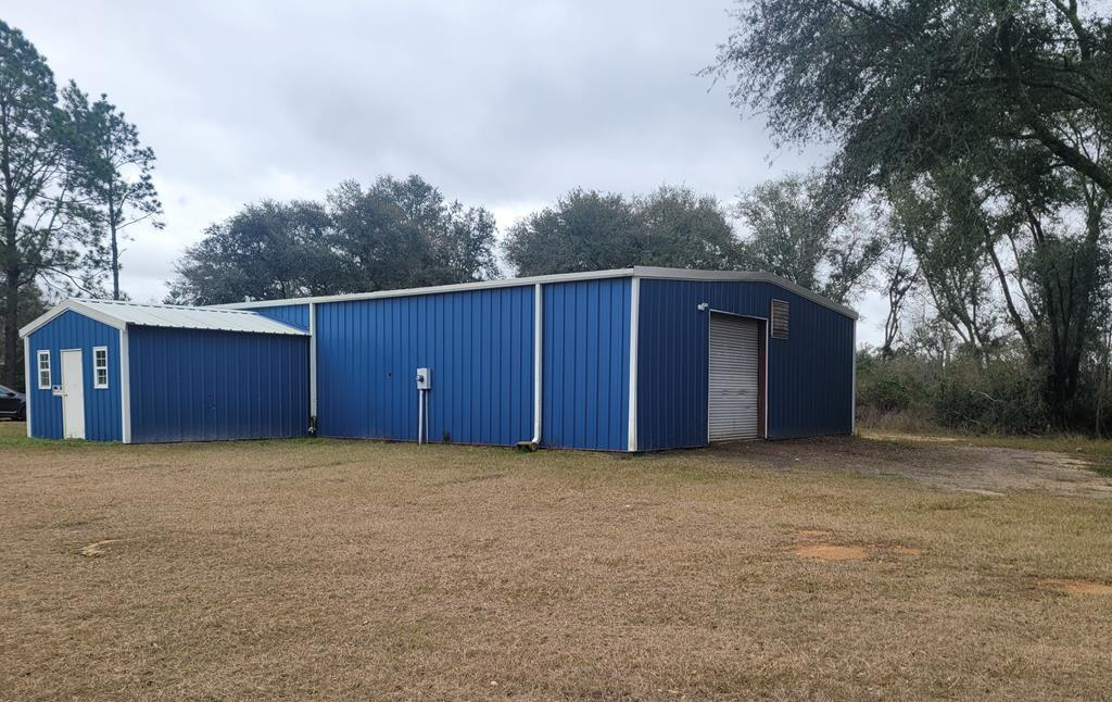Great business location on Hwy 91 with very good visibility.  Conveniently located to Bainbridge area..   This large warehouse has single phase and triple phase electric panels, 14 foot walls with lots of lighting and two large fans . Large roll up door, allows for ease of loading.  There is a 256 sq ft front office and living quarters on one side of the building.   Lots of storage in warehouse above living quarters.  Along the back side of the building is a large carport, almost the full length of the building, with rear door for accessibility.  The living quarters has a new AC unit and new luxury vinyl tile on floor throughout.  This price includes building and 4 acres.  See Listing# 916961  for property including additional 9 acres for a total of 13 acres.   Don't miss out on this opportunity with lots of potential!