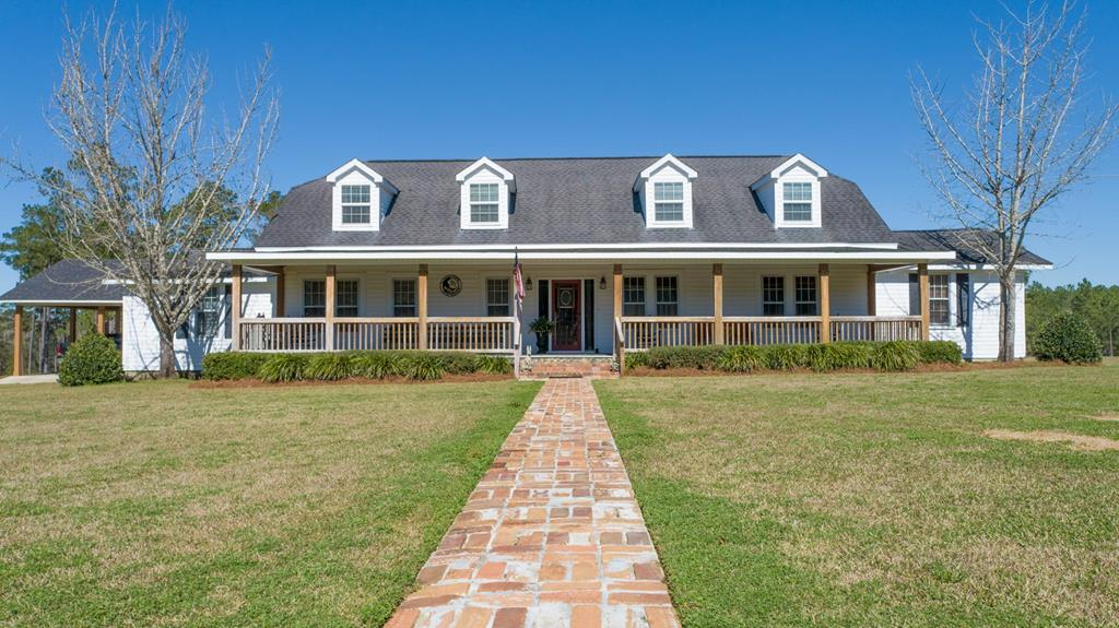 This grand and elegant home stands proud on a sprawling 38-acre lot surrounded by mature trees, lush lawn and established gardens. A charming rocking chair front porch runs the width of the home and provides an ideal place to unwind at the end of the day. Set in the heart of the home is the sensational kitchen where guests can gather as you prepare gourmet delights. Ample cabinet space, a large quartz island and quality appliances will make cooking for loved ones a pleasure. A breakfast area, dining room, sunroom and patio ensure theres plenty of space to spread out and relax plus theres an office/craft room. This impressive floor plan also boasts five good-size bedrooms and four baths including the master with an oversized closet. For convenience, there are upstairs and downstairs laundry rooms, a 10yr old roof and a brand new HVAC. The private and unique driveway leads to the detached covered parking, this picture-perfect property also features a pond and a wooded area for hunting