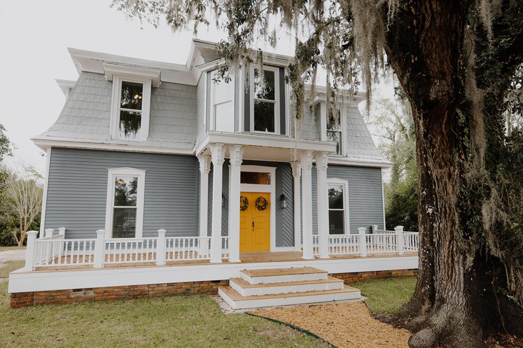 This lovingly restored historic home, Just a leisurely stroll from downtown Thomasville restaurants and shopping, and only steps away from beautiful Paradise Park! Its rare Second empire architecture makes it unique not only in Thomas County, but across the whole nation, as few still exist. This home is indeed a rare gem- the best of both worlds- because it is half brand new home and half historic treasure. The Old wing of the house, built in 1912 with low ceilings, that included the kitchen and bathroom, was removed. The new addition, with high ceilings and architectural details in keeping with the original home, has just been completed 2-2021 to include a gorgeous kitchen and 2 1/2 baths!   The first thing you will notice upon driving up to the house, is the striking front porch. It will sweep your imagination away to the romantic era of yesterday.  This amazing oversized porch, shaded by a powerful 200 year old oak tree, offers unparalleled outdoor living space!
