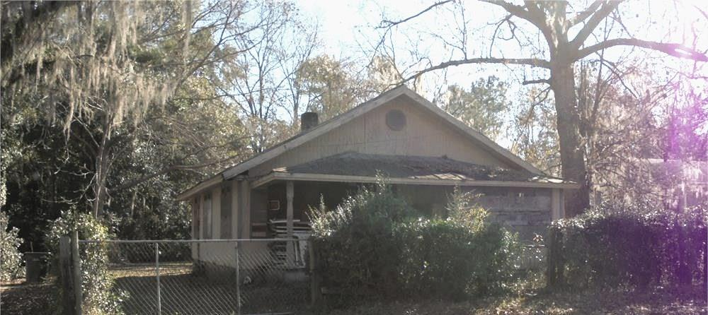 House with good bones.  Tin roof, heart pine flooring, pine walls. Plumbing in place.  Needs HVAC and electrical updating.  This house is on a great lot and has a chain link fence.  Electricity has been off for about two years so it will need City inspection before turning on.