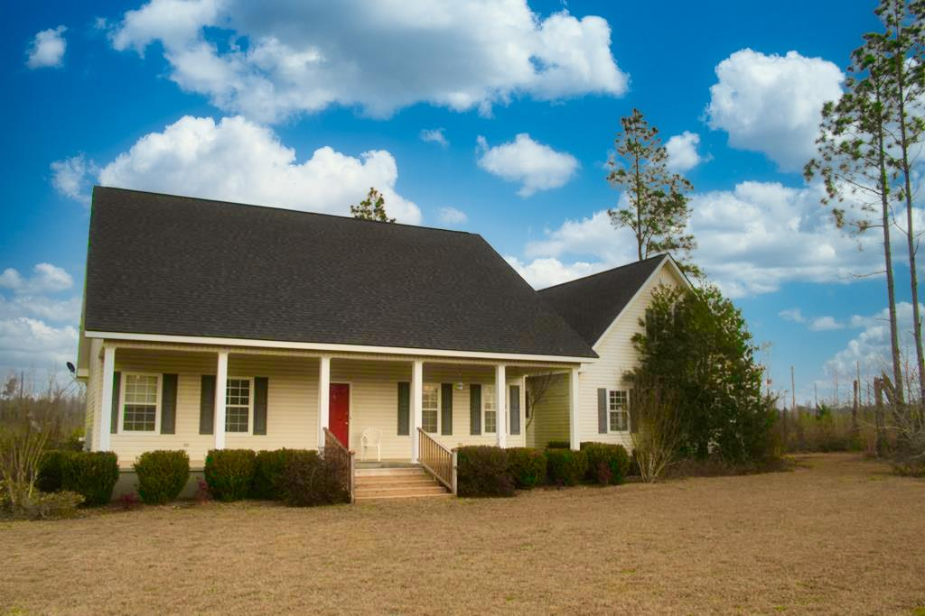 This property is perfect for the hunting enthusiast and a good place to call home. The main house is 2858 sq ft and was finished in December of 2006, and old camp house to be sold AS IS that was built in 1920. This all wooded property is the perfect bedding area for all types of wildlife and is surrounded by a lot of Agricultural land. There are cypress and gum ponds that could  attract waterfowl and plenty of uplands for growing timber.