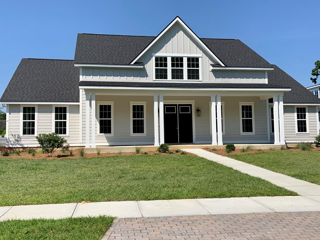 This 5 BR, 4 Bath home is impressive with lots of extras!  When you walk in you will be taken back by the beautiful brick columns encasing the kitchen, the shiplap walls, the tongue and groove ceiling & open living room with french doors & windows showcasing the wrap around back porch! The kitchen is every woman's dream, complete with a Gas WOLF cooktop, pot filler above, double ovens, microwave drawer, breakfast island & walk in pantry! Downstairs you will find an open living area with a gas fireplace and built in bookshelves. The laundry room and spacious Master Suite are on one side of the house with a step up ceiling, bathroom barn door, tongue and groove ceiling and shiplap wall. At the other end are 3 BR, one with it's own bathroom, a separate office AND another bathroom! There is also a very large air conditioned hobby room off of the double car garage. Upstairs is the fifth BR with a bathroom. Lots of outdoor living space, with large front and rear porches & gas grill hookup.