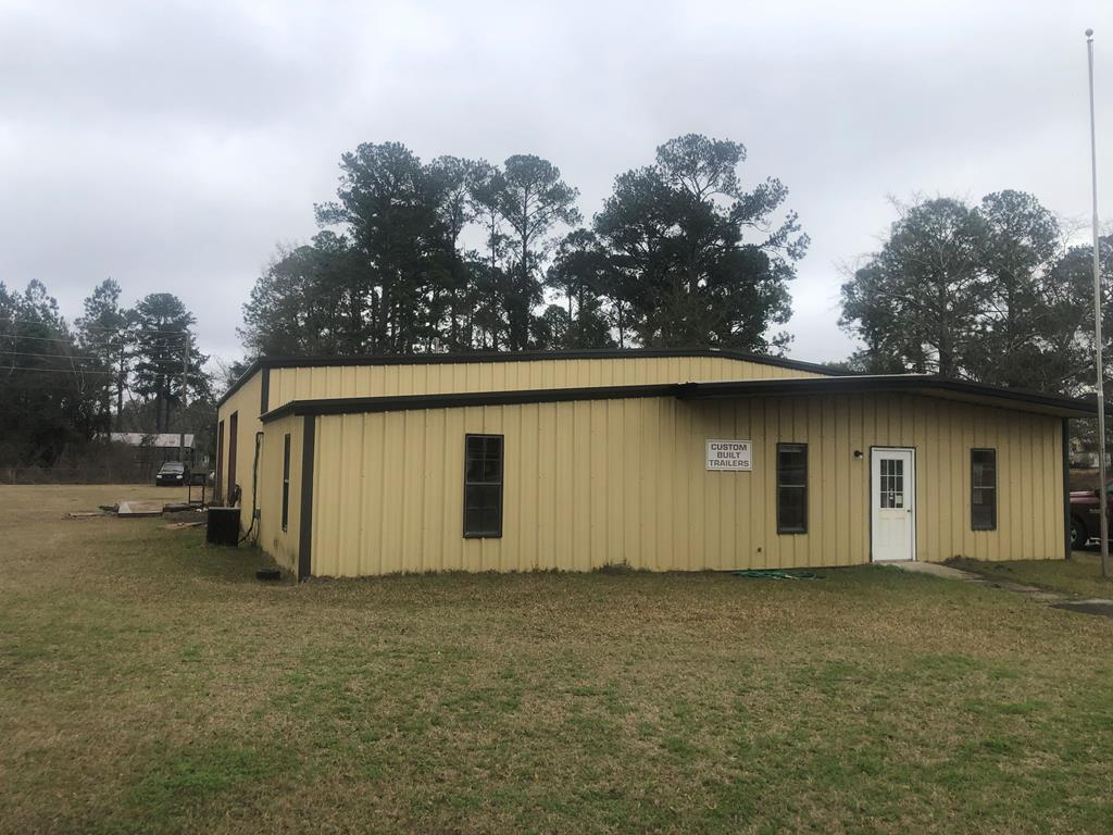 Commercial building that has a lot to offer. Easy access with 4 rollup doors that would make it great for a shop or storage. Great location and visibility. Safe and secure. Property is completely fenced. Building is complete with several offices and roomy shop. For small to mid size business this is a must see. Call today to see.