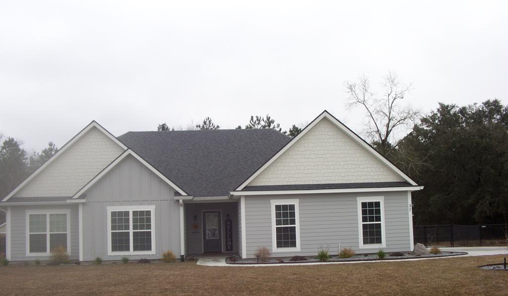 Beautiful custom built home with all the bells and whistles! The foundation was begun in the winter of 2019 and homes was completed in April  2020. One home owner ! This house has hardiplank siding and a professional landscaped yard. Back yard has a gravel area and goes into the tree line past the fence. 3 BDR/2 BA with great open floor plan.  Home has a wonderful eat in kitchen/dining /family room area for great living and entertaining.  Master BDR suite is spacious with lots of windows for light, trey ceiling, custom stone shower, large walk in closet, double vanities and private toilet area.Beautiful engineered wood floors, granite countertops, lots of windows for light and a floor plan that you will love! In the back there is a fence for  a portion of the backyard. This house is immaculate and just like new. Please call for a showing.