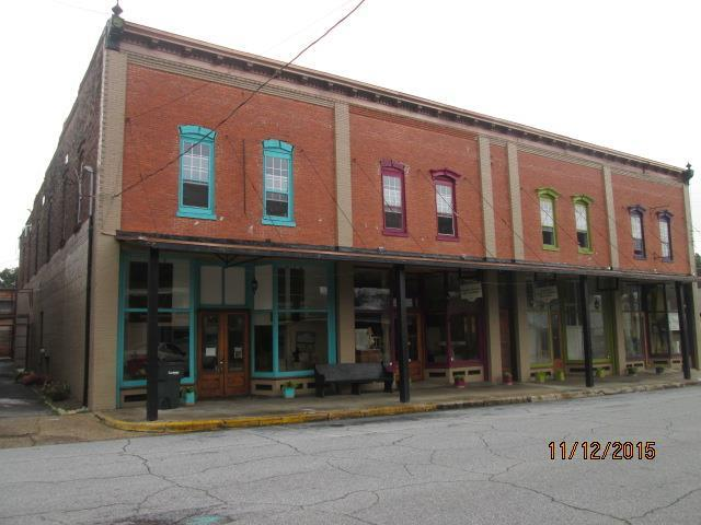 This historic building is located in the downtown area of the beautiful, small southern town of Quitman, GA The building was built around 1890 using brick and Brooks Co virgin pine.  Seller advises building has been renovated and updated with new wiring and plumbing to code standards. One new 5T Ac installed in 2020 that handles 1 unit.  A/C in other units replaced 2 years ago  .There are 6 separate units with 4 having store fronts and 2 having alley access. At the  present time 3 of the units are rented on a month to month basis with $850 per month income. Each unit on separate Elect and water meters.  (The units are offered individually, in multiples or as a whole. Call listing agent for individual unit pricing.) Unit presently known as Yesteryear Memories may be sold with inventory with adjustment in price,  if requested. The upstairs is floored and presently being used for storage. This building offers many possibilities and different uses,, just use your imagination!