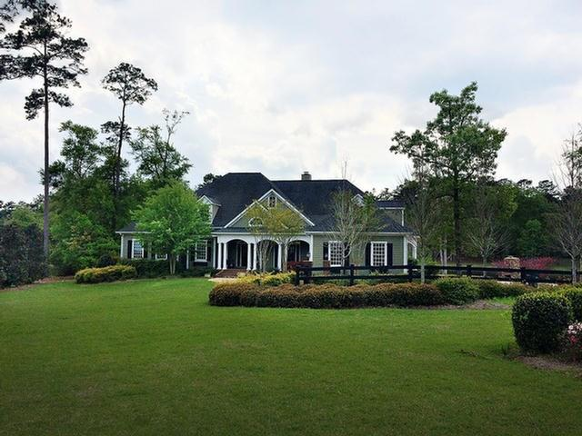 This gorgeous custom home offers luxurious, yet comfortable lakeside living on Thomasville's south side. A large eat in chef's kitchen opens to a casual breakfast area & family room with fireplace & beautiful lake views. The main floor also offers a second living area, dining room, home office, laundry, wet bar, master & guest suites. The serene master suite & sitting area with lake views has access to a relaxing screen porch. A finished basement provides an oversized storage area and more bonus space with lake views and access to the backyard. Upstairs are 3 additional bedrooms, 2 bathrooms & a large bonus area. Closets of all shapes and sizes are located throughout providing abundant storage wherever you need it. If outdoor relaxing and entertaining tops your list, you'll enjoy the numerous deck and patio spaces, gorgeous lakeside fireplace and private basketball court. You're sure to fall in love with the many custom touches throughout this one of a kind home!