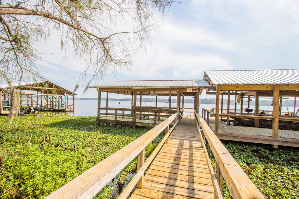 Are you looking for an investment property at Lake Seminole or maybe your are looking for your own get-a-way or forever home! This seller has built a tremendous rental business with this amazing property! It brings in between $13,000 - $18,000 per year. Owner has established repeat rental customers through VRBO. You can find this property on VRBO at #208922. The 1291 s.f. home has 3 bedrooms, 2 bathrooms, very open with plenty of space for bass fishermen, duck hunters, or a family get-a-way. Nice boat house to park your boat and fish from the boat dock. Spring Creek Drive gives you great views of the lake! Whatever the reason you love Lake Seminole, make an appointment to come take a look at this great property!!!