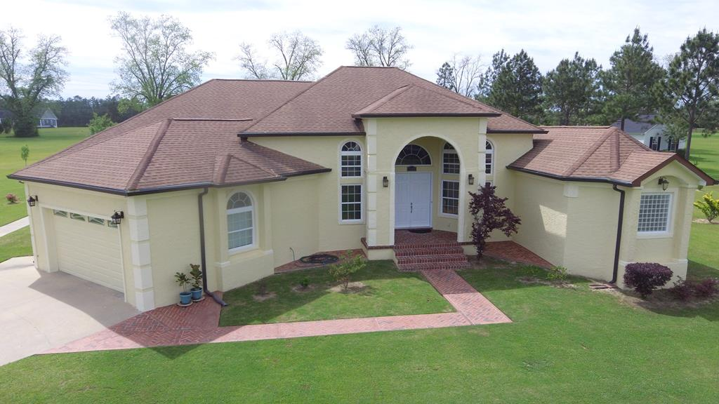 Welcome to this immaculate, custom built home in Hawthorne Trails! Upon entering the front door you are welcomed by soaring, 15 foot vaulted ceilings in living area, and ornate arched doorways and windows throughout. The large primary wing features a gorgeous master bedroom suite, 2 walk in closets, and a luxurious master bathroom complete with bidet, large tub and shower. Handsome marble and hardwood floors throughout. Two spacious bedrooms in the secondary wing share a jack and Jill bathroom, in addition to a flex room that could be used for multiple purposes. Beautiful open kitchen with striking hard surface counters, wine rack, wet bar, and walk in pantry. The primary suite, foyer and living room all open out to a spacious and scenic screened-in patio. The home also features a safe room and big garage. All this sits on a sprawling 2.45 acre lawn that has been meticulously landscaped. Don't miss your chance to see this palace in Hawthorne Trails  call your favorite agent TODAY!