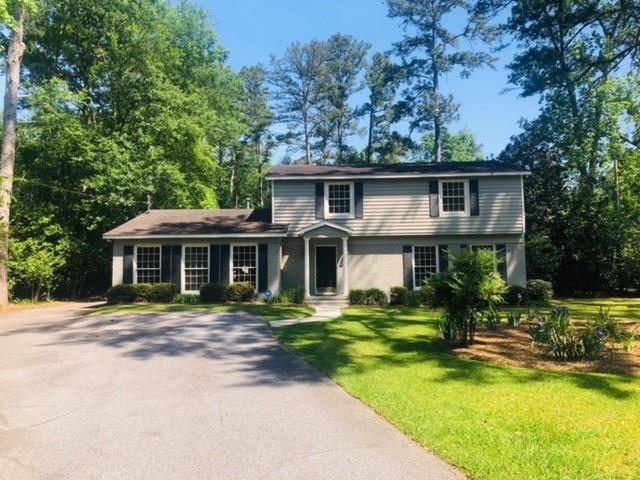 This home is a large, 5-bed/3-bath, 2-story house in a well-established neighborhood near Jerger School, Thomasville Garden Center, and Archbold Hospital. Even though it is large and roomy, this beautiful home is warm and cozy. It has an open floor plan, including a huge living room, with formal dining room, kitchen, and breakfast area. The kitchen offers hard surface counter tops, an abundance of cabinets, desk area, eat-in barand all appliances stay, including washer and dryer! There are 2 primary suitesone downstairs and one upstairs. All bedrooms and the living room are carpeted, while the open dining room, kitchen and breakfast area have hardwood floors, with tile floors in the bathrooms. Four of the 5 bedrooms have two closets. There are floor-length windows across the front of the house, and deep-set windows with window seats in all upstairs bedrooms. There are custom-made wooden window blinds and a neutral color-scheme throughout the house. Huge fenced backyard as well.