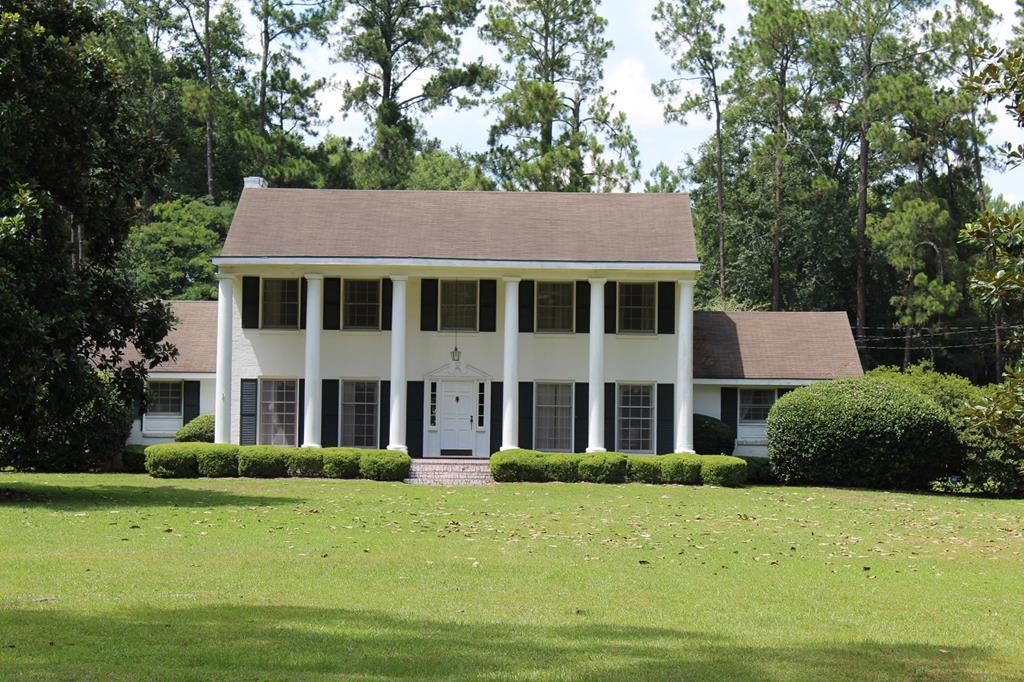 COME HOME TO SOUTHERN COMFORT! Located in the beautiful, historic small Southern town of Quitman, GA this lovely, well maintained Colonial style home is looking for a new family.  The two story home offers the following: Downstairs -  Curved stairway to 2nd floor from Foyer, Formal Living and Dining Rooms. Family Room w/fireplace , Music Room, Master Bedroom and Bath. Master Bath with new tile. The kitchen has recently been refreshed with updated appliances and counter tops. The second floor offers 3 Bedroom, 2 Baths, and a upstairs playroom, which could easily be converted to a 4th bedroom. In recent months both the upstairs and downstairs A/C have been replaced. The Pool House would make a terrific Mother-in-Law suite or Game Room. A patio located just off the Family Room offers a quiet place to enjoy the beautifully landscaped back yard. The home is nestled in mature magnolias, azaleas, camellias, and other southern trees and scrubs. Call today for appt to view your next home!