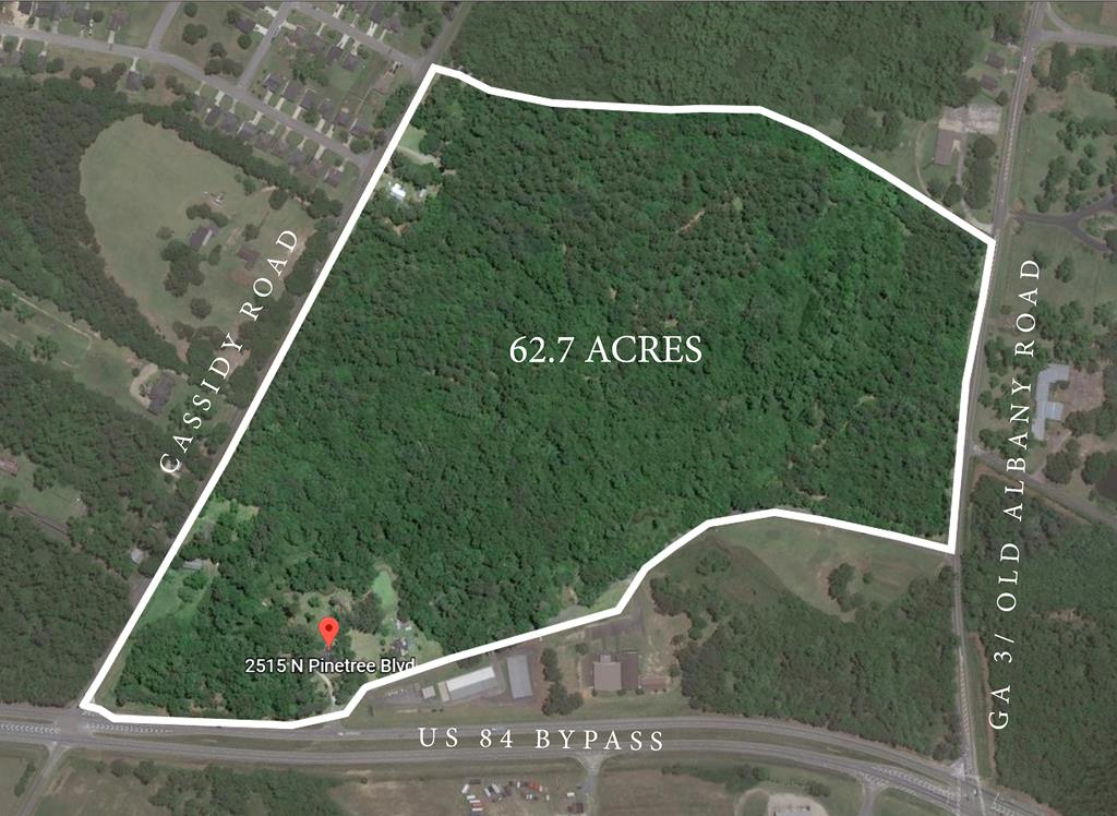 You will not have the opportunity to find this much land in the city limits for a very long time! So much potential with this land and home package. 62.7 acres with potential of a subdivision with three road accesses, this land was previously engineered by the city.  The unique home has a large, open floorplan with plenty of room for family!  Featuring 4 bedrooms with a beautiful primary bedroom, two large living areas, two full baths and a half bath,a huge outside building  with tons of storage space.  This property also features a workshop that is wired.  Don't miss out on this opportunity! Call your favorite Realtor for more information.