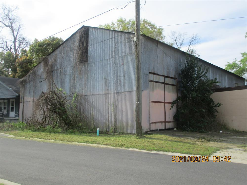 Large commercial building with office and storage space. Will need some work, but the metal framed building has loads of potential! Sold As-Is.