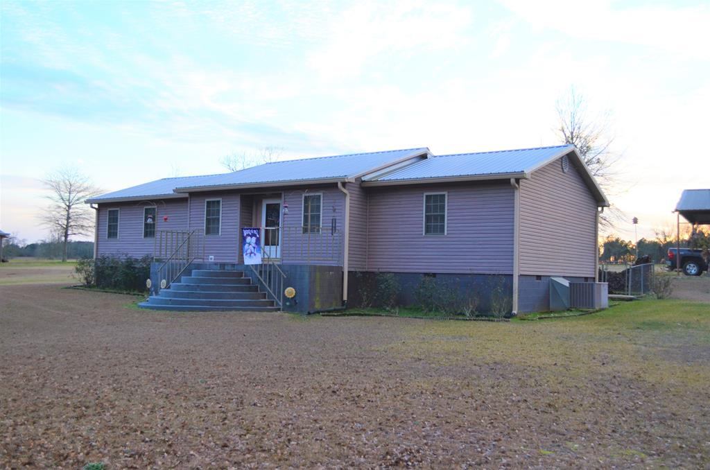 Quaint Farm House with Property located between Thomasville and Pelham, Georgia. Just 25 minutes from the heart of Downtown Thomasville.Land features rolling hills and rich farmland. The east branch of Barnett's Creek flows through the northern end of the property, while the southern end of the property features a two acre pond for fishing. The home is 1,804 sq ft, 3 bedrooms, 2 full baths, spacious rooms and split bedroom floor plan. Central heat and air, with a cozy wood burning stove for those chilly country nights. Recent metal roof, several wired storage buildings, including large garage, separate utility building with large loft, and well house that includes additional storage. This gentleman's farm is well kept and equipped for endless opportunities for work or leisure.