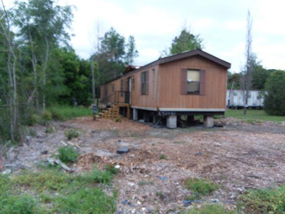 Handyman Special !   2Br. 1Ba located off US Hwy 84 East in Boston. Single wide mobile home was relocated  to this site recently. Water, sewer, utilities and HVAC have not been connected. Seller decided to relocate and has not occupied this home.. Subject property is sold as is. Seller nor agent makes any guarantees or warranties either expressed or implied as to the conditions of the improvements.