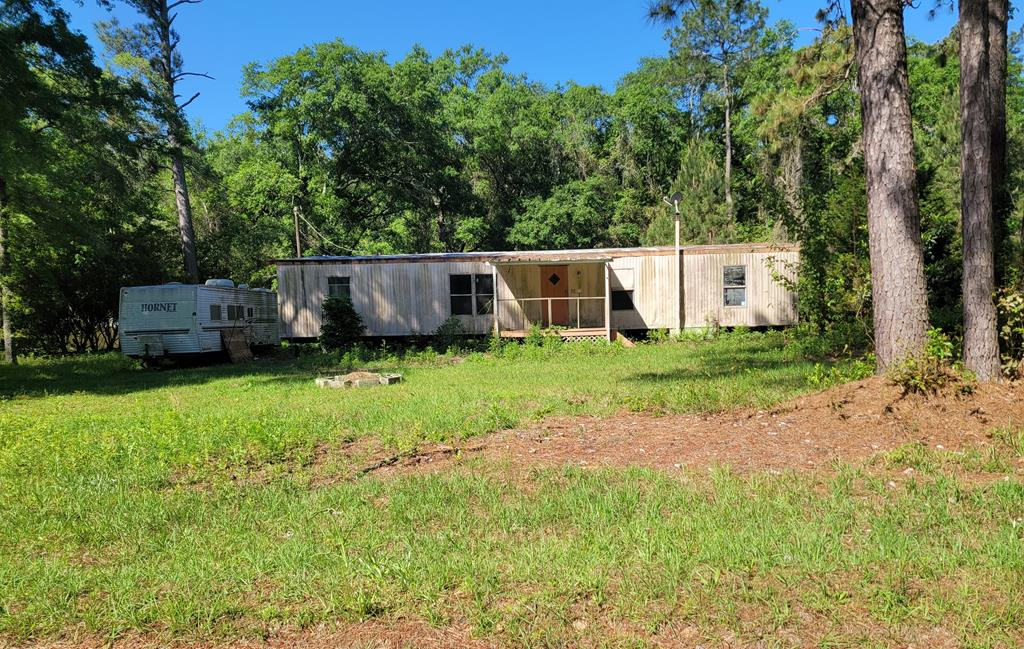 """Handyman special in Riverwood subdivision.  This mobile home has been gutted and is ready for someone to finish it off and add their final touches.  This is on a 5 acre tract .  The properties in the area have mixed use zoning.  Subject property is being sold """"As Is"""".  Seller nor agent makes any guarantees or offers any warranties either expressed or implied as to the conditions or improvements."""