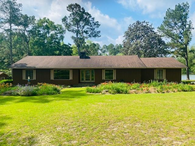 This charming 3BR/2 Bath house is sitting on 3.25 acres with 2 ponds.  Inside you will find a split floor plan that opens up to a large Great Room overlooking the Kitchen.  The Great Room has a wood burning fireplace and plenty of room for family gatherings and/or entertaining.  On the back of the house you will find a huge sunroom with view of the stunning back yard and the two ponds.  The kitchen and bath rooms have been updated with new cabinets and granite counter tops.  There is a 20' x 40' wired shop with 2 garage doors.  It is divided into two rooms, one with a half bath.  The property is full of amazing landscaping with lots of flowers.  All this and only five minutes from downtown Cairo, it is located in a very well-established neighborhood.
