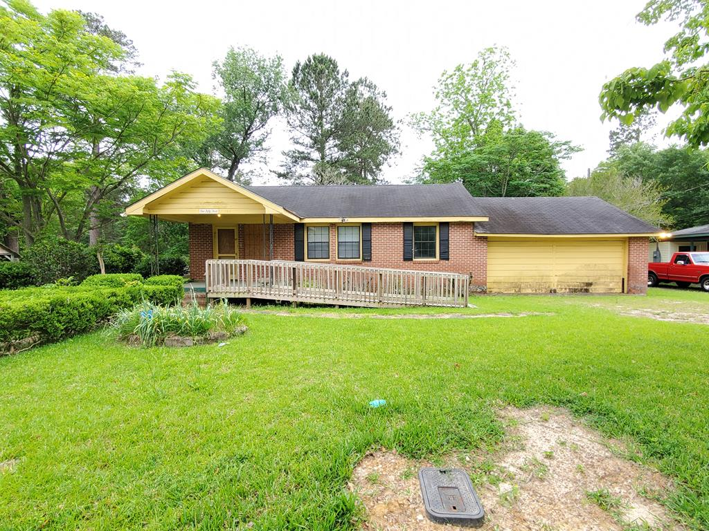 Investors and homebuyers don't let this brick home get away. This 3 bedroom 1 bath has lots of potential and it comes with a double car garage and an additional lot.  Air conditioning system only a few years old.  Call to schedule a showing right away.
