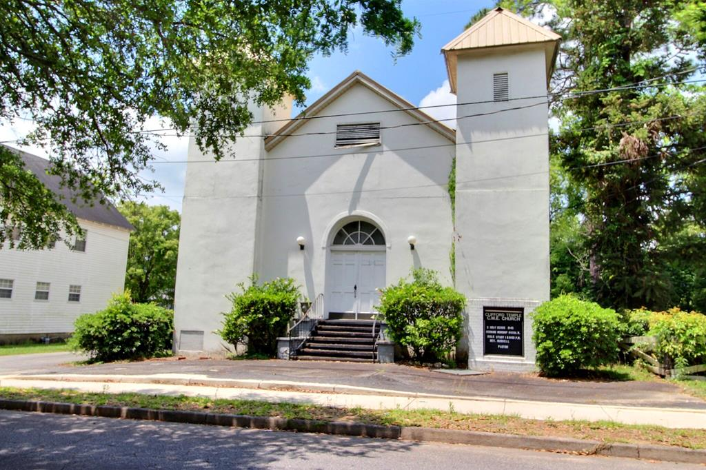 Historic architecture style church building located in the Fletcherville neighborhood has brick veneer exterior and metal roof.  Formerly the location of the Clifford Temple CME Church, this building is ready for a new group to breathe life into it and make it their own. The building features a large clear span vaulted ceiling sanctuary with raised pulpit area and choir loft.  Two private bathrooms are located off of the front foyer and two private bathrooms are located between sanctuary and fellowship hall area. The attached annex building is accessed from the main sanctuary or the side double doors under the carport. This part of the building features 9 offices/classrooms and  located off of the fellowship hall. There is a spacious kitchen with lots of prep space and double pass-through windows for serving.  Large asphalt parking lot AND extra overflow lot located at 101 Bryant Street (.24 acres) is included with this sale. Call today to check out this opportunity.