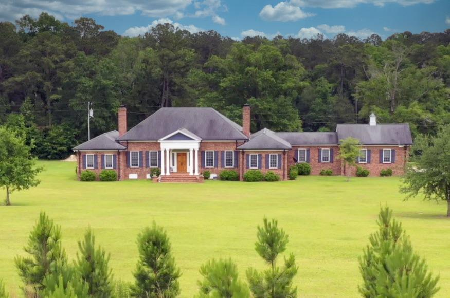 Amazing opportunity now available in Grady County for a Gentleman's Farm with an easy drive to Tallahassee, Cairo or Thomasville. Over 50 acres of pristine manicured land including main house, guest house, shop building, pond & 5 yo planted pines (5000 seedlings). Main house built in 2008 is a William E Poole brick classic w/ 4,198 sf for 2 BR & 2.5 BA plus office & den w/dual sided fireplace, oversized great room, pond-view dining, gourmet kitchen & screened porch off of the summer kitchen patio. Main house supported by whole house generator. Guest house built in 2005 is well appointed w/1,420 sf for living room, kitchen, one bed & full bath w/3 car garage + screened porch overlooking pond. Shop building is approximately 40' x 50' w/10' lean-to and has 3 overhead doors suitable for farm equipment, RV& boat storage. Grounds have gated entrance lined wi/ mature plantings & gravel drive leads to asphalt at the main house. Other plantings include pear, plum, pecan & blueberries.