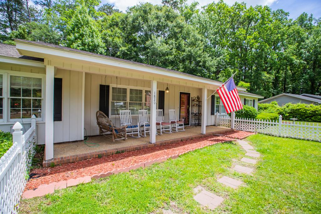 """Call and schedule your tour today for this new listing in a desirable location with well maintained home in the cul-de-sac with over 2,000 square feet featuring 3 bedrooms, 2.5 baths with bonus room. Your family will definitely have room to grow in this home with all the conveniences Thomasville has to offer including schools and shopping very nearby.  Your family will enjoy the large open great room with wood burning fireplace featuring a stacked stone hearth and accent wall, updated kitchen with granite countertops, stainless steel appliances and an abundance of cabinets and storage space including a built in pantry with pull out drawers. The separate breakfast area offers outdoor views of the double lots through the large picture window. Current owners created a """"Barista"""" space where they enjoy morning coffee, or it could double as a bar/entertainment area. Anyone would envy the spacious laundry room complete with utility sink and lots of storage.   Crown moldings, carpet, tile, and laminate wood can be found throughout interior along with custom built ins and bookcases. All bedrooms and bathrooms are of good size and can meet the needs of a large family. The master bedroom includes a bath and the other two bedrooms share a Jack-n-Jill bath.  You will especially enjoy the home office or library just off the kitchen with lots of shelving for those who are now working from home. Take a break, walk outdoors and enjoy back yard entertaining on the large patio and around the firepit.  You will find a covered rocking chair porch on the front.  Outside features a powered RV landing with 30 amp service and a 12 x 15 powered outbuilding/shop.  The carport area features a bonus room and a large workspace/storage area."""