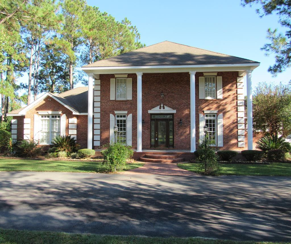 Everything you have been looking for is right here tucked away in a beautiful peaceful setting on 25.82 +/_ acres. Surrounded by nature, wildlife, planted pines, a stocked pond, and plenty of room to roam. The home was built in 1999 and has remained in excellent condition. Features include arched doorways, detailed crown molding, hardwood floors, high ceilings, custom cabinetry, new appliances (TWO cooktops/double ovens), center island w/ sink, laundry room w/ full bath, built-ins, a tons of windows! Outdoor fireplace on porch, hot tub, guest house, and 20x30 wired workshop. Perfect for horses and hunting. Conveniently located between Moultrie and Thomasville.