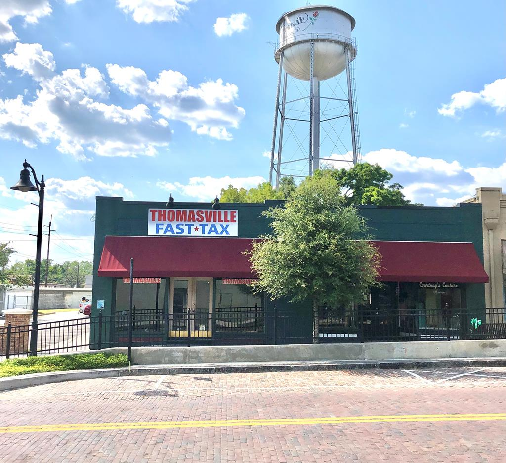Great Location Downtown near Shops and Retail Stores. Newly Improved Area just across the Street from the New Ritz Ampitheater. Plenty of Public Parking in the newly renovated Public Parking Lot. This Building would be Ideal for a Large Formal Restaurant , Convenience Store , ect . with a total of 5- Bathrooms. Currently Leases are all on a month to month basis. Seller has to give tenants a 60 day notice or continue their leases. Owner just had a Brand Nw Roof on Entire Building and is warranted. Very high traffic area and walking traffic as well. Ampitheater hosts many events throughout the year. Lots of Opportunities Are knocking here. Seller is a Licensed Real Estate Broker in the state of Georgia.