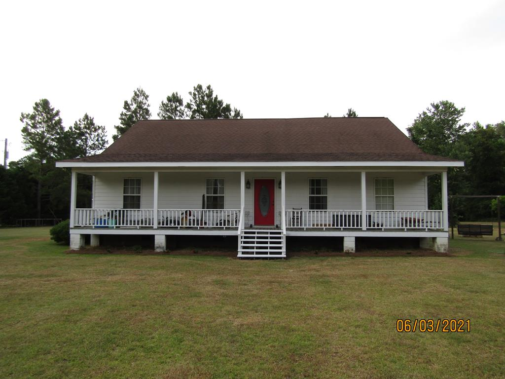 Mitchell county country living at its best, located just outside of Pelham.  Quiet country setting located on 10.24 acres with a 4 bedroom 2 bath home.  Property has almost 100 Creek and Sumner Pecan trees on the front half. This home has a wonderful front and back porch for your perfect morning or afternoon. The house is located in middle of the property with a nice fenced in area for live stock behind the house. This land has both turkey and deer that roam the property. House has an open floor plan with full access of kitchen, dining and living room. Master bedroom is spacious, has a walk-in closet, large vanity, a garden tub, and a separate shower.