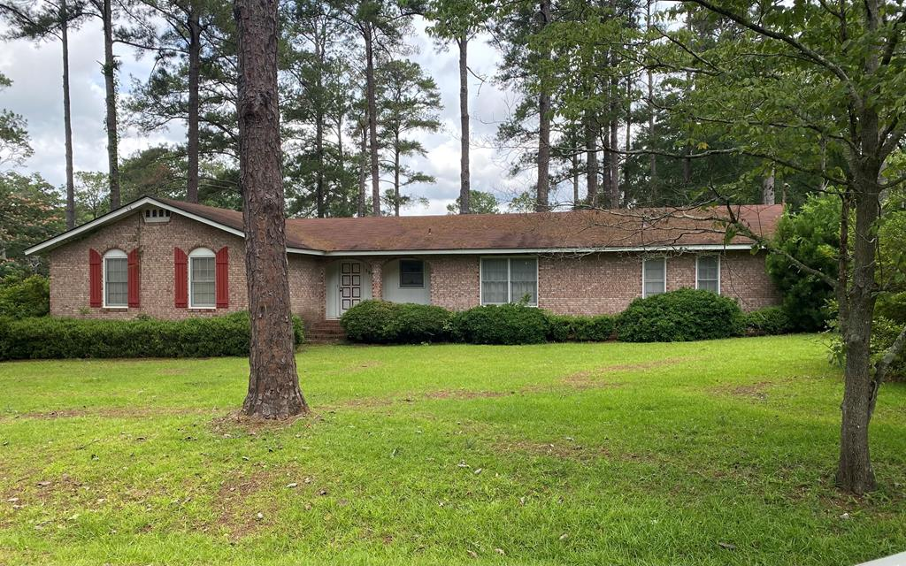 A beautiful brick home on a pretty corner lot with lots of shrubs and mature plantings. This lovely home has so many features for this affordable price. Entry has a huge living room opening to a spacious dining room. Then the entry to the den is from the double carport and den opens to a brick walled patio looking out on towering trees. Each of the three bedrooms is really spacious with the large hall bath. Master has a walk-in closet and bathroom with a walk in titled shower. There is a separate laundry room, not just a washer and dryer area, but enough room for a freezer too. Kitchen has oven, refrigerator, stove surface unit and dishwasher too. Often we hear buyers wanting a solid, well maintained brick home but are not able to afford the higher prices brick brings, Well thiis one is so affordable and move in ready, but in this market may not last long. This traditional brick home in such a nice area is a really good opportunity.