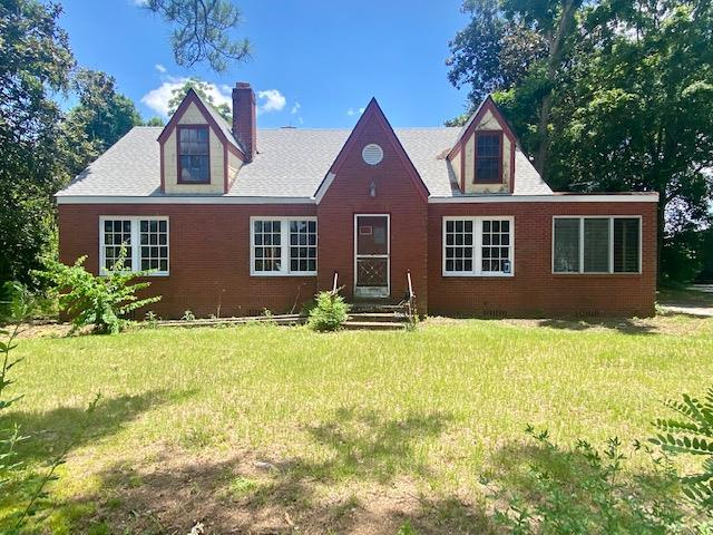 Cottage Style brick home is ready for you to make this your very own! 3 bedrooms/1 bath home located on a spacious 1 acre lot with fruit trees. Original hardwood floors, sunroom and bedrooms with real tongue and grove walls. This home is truly  unique!  A bonus room upstairs could be used for an additional bedrooms or for a family game room.  Renovations have begun and now you can finish it and make it your on. New electrical wiring and roof in 2020.