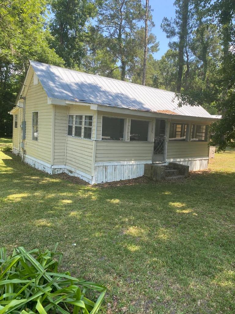 This home is an excellent rental investment property and has rented in the past for over $500 per month.  The home has been freshly painted and includes new carpet and flooring.  Metal roof.   Needs some work.  Large corner lot.  The agent is related to the owner and holds a GA REAL ESTATE LIC. 310440