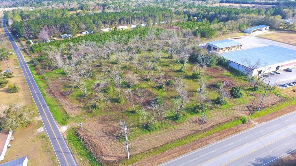 Commercial Acreage. Tract is located next to Stone's and has two road frontages. Tract is high and dry and has many possibilities. The photos above are showing views from North, South and East. Call agent for more details.