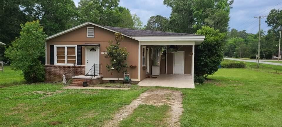 ABSOLUTELY adorable, close to everything, large fenced yard & a carport !!! Granite counter tops, tile floors & gleaming hardwood. Large master bedroom with sitting area!! This is a great home, whether starting out or retiring, super easy upkeep ! Appliances included !!! Don't miss this adorable home -- it won't last long!