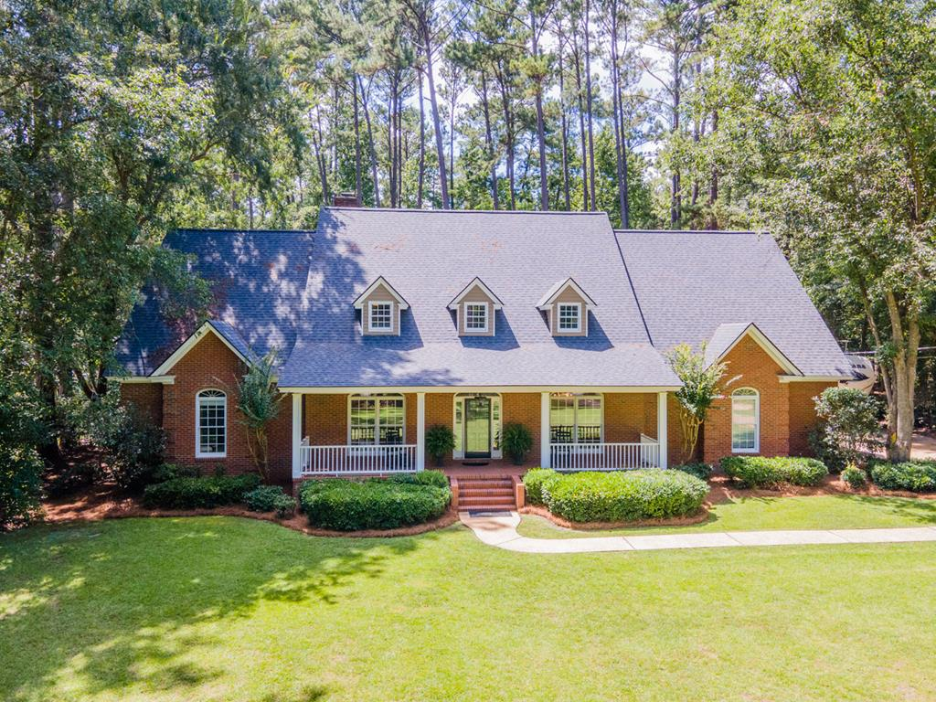 Offering privacy and convenience, this traditional home sits on a quiet cul-de-sac and is less than five minutes from Jerger School and Archbold Hospital. As you step into the welcoming foyer, you find a time honored dining room on the right and living room on the left. Continuing into the great room, you immediately take notice of the gorgeous high ceilings with custom crown molding. Additionally, there is a traditional wood burning fireplace flanked by handsome built-in bookshelves. The great room opens onto the covered back porch where you can take in the spacious backyard and newly built deck -- a wonderful location to host parties and get-togethers. The kitchen features stainless steel appliances and a beautiful bay window that offers deck views. Adjacent to the kitchen you'll find a laundry room with a large rinse sink and ample space for hanging clothes. On the first floor, you'll also find a guest bedroom and bath along with the master suite. Downstairs living quarters have been recently updated with fresh carpet and paint. The expansive master suite sits in the back of the home, offering privacy and respite. The master bath features a large garden tub, recently installed step in shower and adjoining his/her walk-in closet. Walk upstairs to find a large bonus room that's been uniquely reinforced to also function as a weight room if one so desires. This sizable room would be perfect to serve as a home theater, playroom or gym. Two additional bedrooms can be found upstairs as well as a Jack-and-Jill bathroom.  Recent updates to the upstairs include all new oak engineered flooring as well as fresh paint. Everyone's favorite feature of the upstairs is the large amount of storage. You'll find not just one but TWO walk-in attics. One could use them both for storage or easily enclose the smaller hallway attic to make it a private computer room or office. At over 4100 square feet, this wonderful home boasts plenty of space.