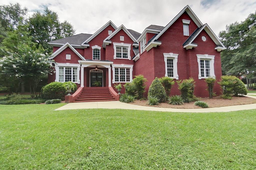 Lake life is the best! Brand new to the market, this private luxurious home, in gated Riverwind Plantation has every feature you can dream of. Soaring two-story ceilings in the foyer and great room that are overlooked by the 2nd floor balcony create a grand space to gather around the fireplace. Custom kitchen with an eat-in bar, upgraded stainless steel appliances and gorgeous granite countertops, was designed to impress. The breakfast area opens onto a screened porch, suitable for quiet mornings as you sip your coffee. The fully enclosed, heated salt water pool was custom built to the owners exact specifications for privacy and relaxation. This beautiful oasis features a whirlpool, waterfall and a shallow water splash pad. A cozy living area open to the kitchen is perfect for a quiet evenings, featuring another gas-log fireplace. As you walk toward the large 2 car garage, you will pass through the built-in office area and by the game room, which would be suitable for exercise equipment or additional guests. Sunlight floods the  elegant formal ding room off the main foyer and a butlers pantry comes in handy for special dinners. Directly across the impressive double door foyer is the handsome home office. With a closet and full bath, it may also be used as a 5th bedroom. A king sized master suite, with a sitting area and a fireplace, is the capstone of this magnificent home. The opulent bath and spacious closets are well-appointed and designed for comfort and ease. The laundry area is efficiently located near the upstairs bedrooms, saving you time and effort. You'll love living at Riverwind! Call today for an appointment.