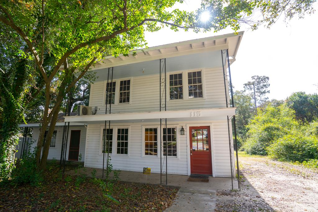 Perfect location! Beautiful, well kept historic family 4 BR/2 BA home. Original heart pine floors and walls downstairs and upstairs. This property is excellent for the buyer that wants to be close to downtown Moultrie. The property has been used as an office space for a local business but is intended for your residential home! The electric has been updated.Huge front yard and back! This house has a lot potential. Make your appointment today!