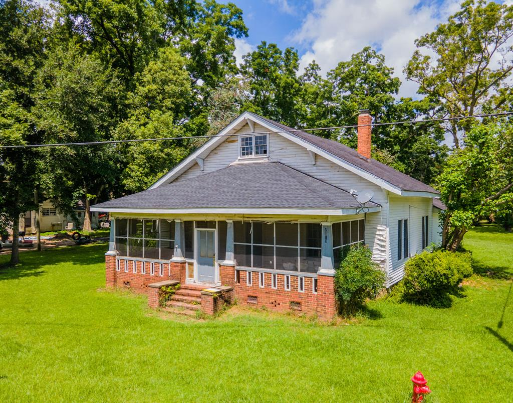 This spacious historic home in humble Ochlocknee is calling your name! Just a quick 18 minute drive to downtown Thomasville, and also convenient to Meigs and Pelham. This sprawling home makes excellent use of 3,320 Sq Ft. Featuring 3 large bedrooms, 2 baths, and a huge bonus room up stairs! The large living area and formal dining area both feature built-ins and a decorative fireplace. Just passed the formal dining area is the huge kitchen featuring ample cabinet and counter space! The roof was completely replaced 4 years ago. Outside is a storage shed and concrete pad. Home is sold as-is.