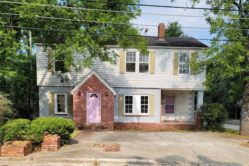 Investor Special!  This 4 BR/2 BA home has good bones and character in its design.  Some work has been started but is not completed.  Home has hardwood floors throughout most of the house.  Vinyl in the laundry room and tile in the kitchen.  It has tongue in groove walls that could be gorgeous when sanded and stained.  All it needs is for someone to finish what has been started.  Outside pictures only due to work in progress on the interior.  Additional 700' block building comes with the property.  It needs additional work but could be renovated as an additional living space or for storage.