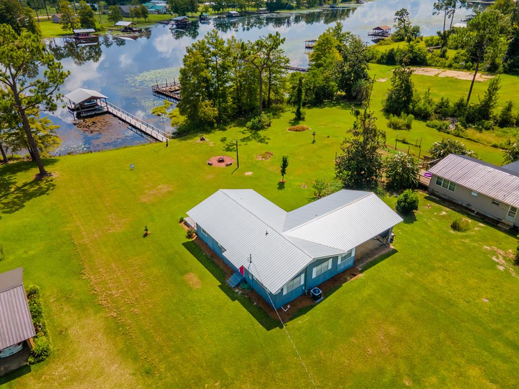 Are you looking for a turnkey property at Lake Seminole? This is IT!!! This 3 bedroom, 2 bath home would be just perfect for your family get-a-way, permanent residence or a Vacation Rental By Owner. This property is located on Fish Pond Drain, which means there is lots of fun if you like water sports. There are no stumps and it's near the Seminole State Park. The home is open and spacious with windows galore. You will enjoy spending time overlooking the activities going on on the lake. The boat house comes with not one, but two boat lifts and you can enjoy swimming around your dock. Sit out on your back deck and enjoy the serenity of the lake. Plenty of yard space for vehicles and boats. Don't miss this opportunity to own this great property!!! Call today for your showing.