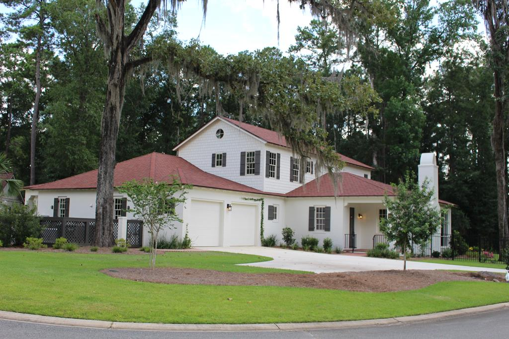 This gorgeous 3 bedroom 3  bath custom Cecile Place townhome includes heart pine wood flooring throughout the home, master bedroom on main floor, brick and shake exterior, masonry fireplace, upgraded appliances, a whole home standby Generac generator, a large climate-controlled garage, enclosed sun porch and many other features and extras!     Glen Haven is in a uniquely convenient location, one mile from the brick lined streets of historic downtown Thomasville and sculpted on 34 acres from the Devereaux Plantation Estate across from Glen Arven Country Club. Glen Haven features an abundance of magnificent specimens of white oak, magnolia, live oak and mature pines. The neighborhood has been carefully designed to accentuate the beauty of historic features and reserve its natural character by incorporating two large parks and strategic use of green space, buffers and surrounding vistas.