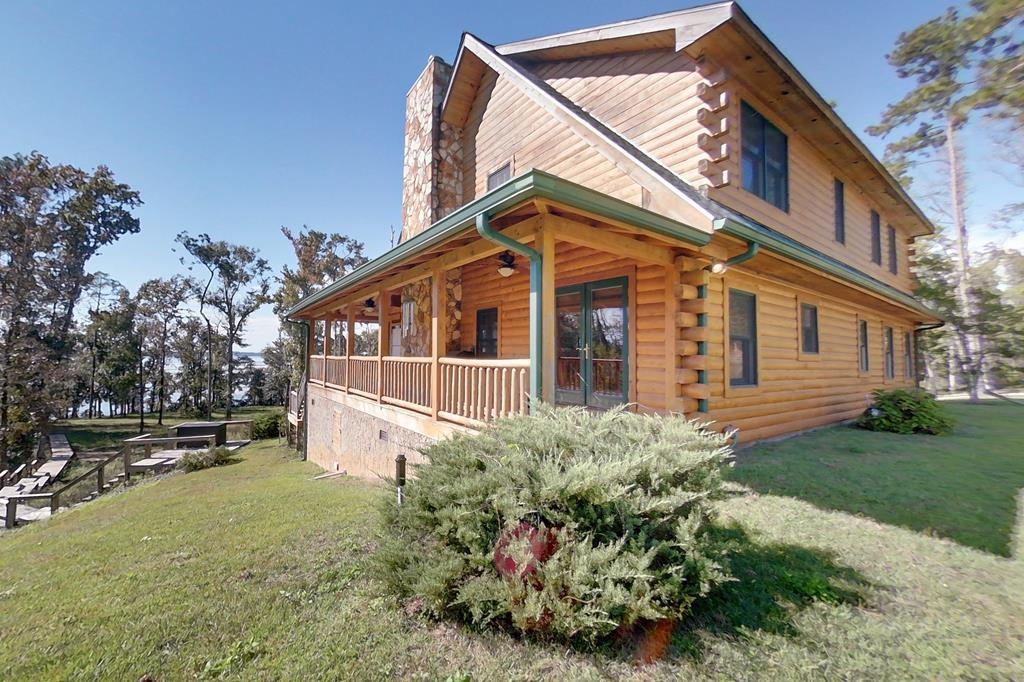 ON LAKE TIME! Make this piece of paradise your next home away from home. This impeccably maintained log cabin, designed by Flint River Log Homes, sits on 1.5 acres on the gorgeous Lake Seminole. As soon as you step foot in the front door, all your stress will go out the door! The entryway and living room boast 24- foot ceilings, with pine from top to bottom. The open floor plan allows for family and friends to gather over fresh caught fish for dinner, and then cozy up next to the wood burning fireplace with a cup of coffee and dessert.  With a first floor master that expands the entire width of the home, you'll find plenty of room to host family and friends. As incredible as this home is, you won't want to miss what the outdoors have to offer. Enjoy the sunrise from your screened in porch, or head on down to the 29'x32' dock where your adventure begins. Whether you're looking to take it easy and cast a line, or be a little more adventurous and go water skiing, your 12'x27' boat slip/lift will make any adventure a breeze. The property also has an 8'x10' storage shed to store all of your lake side necessities. New HVAC unit was installed in October 2020. Escape from the hustle and bustle and call this gem your own! Call your favorite realtor today for a showing.