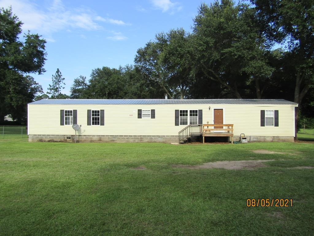 This 2 bedroom 2 bath has everything, move in ready, new roof, paint, flooring, appliances, all new from one end to the other, this is a must see. Covered back porch, property fenced in, nice work shop for any tools and storage with a lean too for trailer or vehicles.  Perfect location to everywhere, within 10 minutes to Baconton Charter, 20 minutes to the Albany mall, this is a must see.