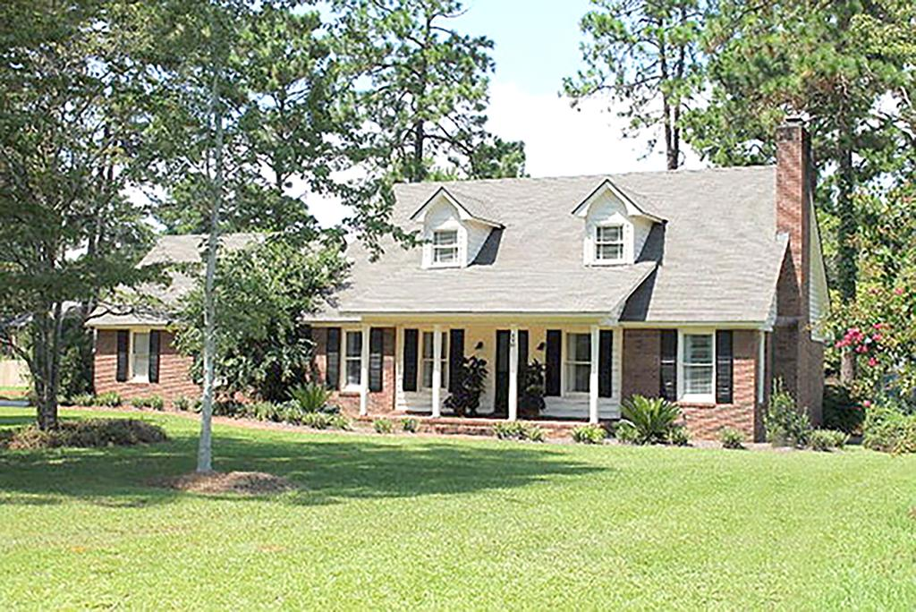 This beautiful home in popular Northwoods Subdivision is 3 bedroom, 2.5 baths and is conveniently located near schools and shopping.  The home boasts designer light fixtures, Brazilian hardwood, granite countertops throughout and much care given to every detail.  A spacious family room with fireplace, dining room, gorgeous kitchen with stainless appliances, island and breakfast area, as well as a sun porch with large barn door, make this home inviting and great for entertaining. The master suite includes double vanities and walk-in-closet.  Upstairs, two spacious bedrooms and jack and jill bathroom with two vanities complete this charming home.  Make your appointment. today.