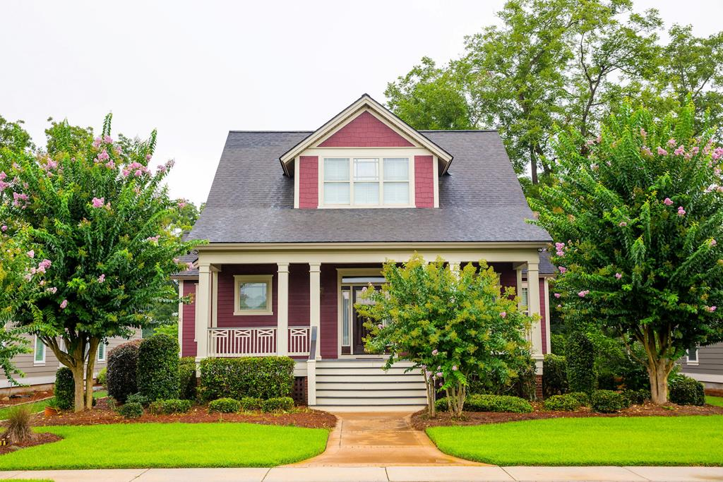 Beautiful New Orleans style bungalow in Madison Grove Subdivision.  3 bedroom 3.5 bath two story with a large welcoming front porch.  Custom cabinetry in kitchen, laundry, and baths.  Stainless steel appliances.  Custom builtins in living room with gas fireplace.  Walk in shower in the master, with separate jacuzzi tub, and oversized closet with custom shelving.  Upstairs has two large bedrooms with ample closet space, and walk in attic for additional storage.  Outside you will find mature landscaping with sprinkler system, custom stamped concrete drive and walkways, and a workshop/storage area with roll up door, concrete flooring, and power.  Roof is currently in the process of being replaced on the main residence.