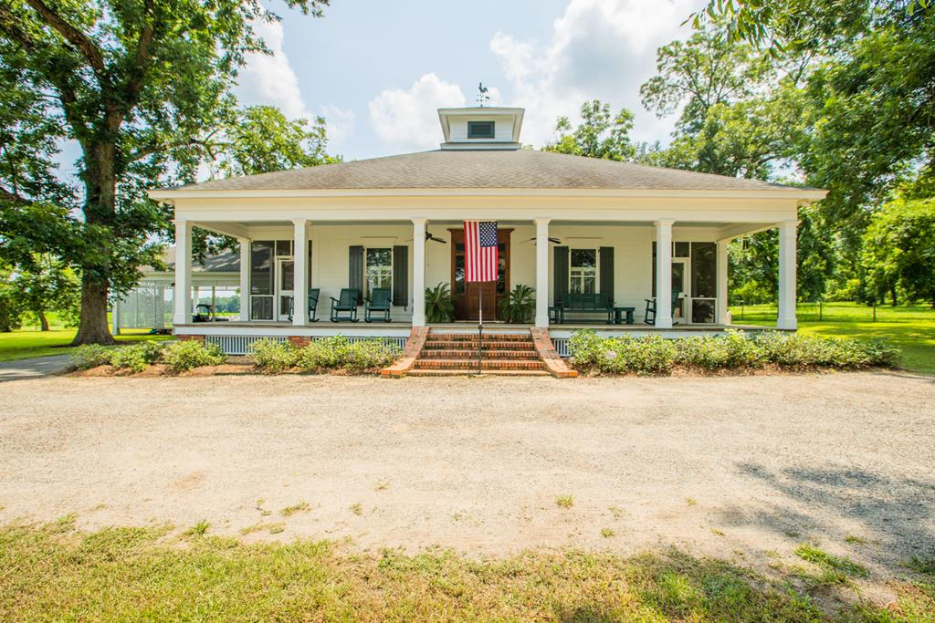 """Located in the Red Hills Region in Thomas County, GA, South of Boston, and next to Merrily Plantation is Woods' Edge. A South Georgia Home and Farm, consisting of 70+/- acres of Rolling Fields, a few Pecan Trees, a full canopy of Live Oaks, Hardwoods, and Pines. The home was constructed in 2009 by Albany builder, Jimmy Fuller- Architect  William Phillips of Dauphin Island AL designed for Southern Living.  Boasting (4000+/- Sq Ft under roof (2,678+/- Heat and Cooled) per Thomas County Tax Records, Verify) the home is a showcase of re-claimed heart pine and well-planned living space. Much of the re-claimed heart pine and some brick were taken from a storied cotton mill in Albany, GA.. There is a Formal Dining Room, and a Living/Great Room Area with a Cypress (gas) fireplace. The master BR has a spacious and well-appointed walk-in closet, and the master bath holds an abundance of natural light with double/separate vanities, soaking tub, separate shower, and water closet. There are custom plantation shutters throughout the home with 7 sets of French doors, 3 screened porches, and a center hall that is similar in design and function to a """"Dog Trot"""". Catching gentle breezes through this home really is a """"Breeze."""" There is too much to tell and even more to see and appreciate. The Guest Cottage was built from a design based off a relic building used as a doctors office. The towering front door of the guest cottage has a story to tell and has likely seen history that you and I can only read about. The white wood fence, the heart pine, and all the details blend to make this an inviting cottage for any guest or visitor. The 70+/- Acres consists of about 30+/-   rolling acres of cultivation that could  be turned to pasture.  The balance of the property is mixed old growth hardwood and pine sloping gently towards the Aucilla Creek/River System.  Excellent Hunting in this area!   Top Shelf!  Always be on the lookout for arrowheads when walking around the fields near the Aucilla."""