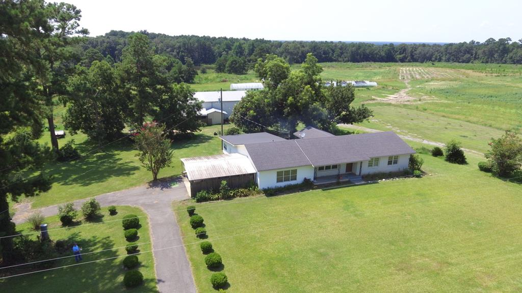 Farm Life - dogs, horses & cows welcome!!!  This brick ranch home, pond and metal building sit on a beautiful 37.5 acres in North Grady County.  The home features 3 bedrooms, 3 baths, two living rooms, gym / bonus room and a newer kitchen.  There is a double carport and a 50x60 metal building with roll up doors, power and water.  The property has been used for growing organic produce and can easily be farmed or turned into pasture.  One of the main features of the property is the +-2.7 acre pond.  The green houses on the property are in the process of being removed and the walk-in cooler in the metal building is not included..
