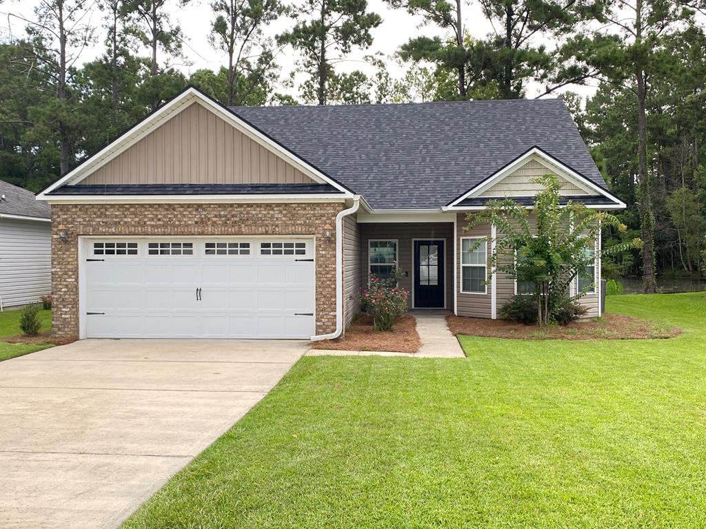 This adorable 4 bedroom 3 bath home has all the space you need with the convenience of in-town living!  It has a split floorplan with a huge bonus room and full bathroom upstairs that's perfect for a 4th bedroom (current use), playroom, office, mother-in-law suite, or media room.  Home overlooks the pond but has a fenced (privacy) yard with covered back porch for grilling or relaxing. Tasteful, modern features include tiled flooring in the bathrooms, master tiled shower/tub, tiled kitchen backsplash, white cabinetry, crown moulding (master bedroom/bathroom, kitchen, dining room, and living room areas), and black plumbing/lighting fixtures and knobs throughout.  New carpet in the bedrooms, a 2 car garage, and huge mud/laundry room complete this move-in ready property.