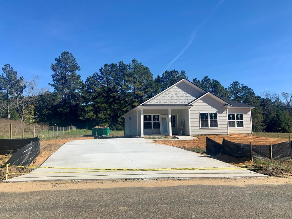 New Construction home scheduled for completion Mid November.  This new construction home is owned by a licensed realtor in the state of Georgia.  License number 106345.  3 bedroom, 2 bath home, convenient to schools, grocery stores, churches and ball fields and parks.  See plans attached for details.  Specifications coming soon on colors, granite, flooring, tile and cabinets.  Price, Plans, Specifications, Colors, Materials, etc. are subject to change. Please inquire with an agent for details.  Local recreational fields are one block from this home and multiple churches, shops and eateries are within walking distance.