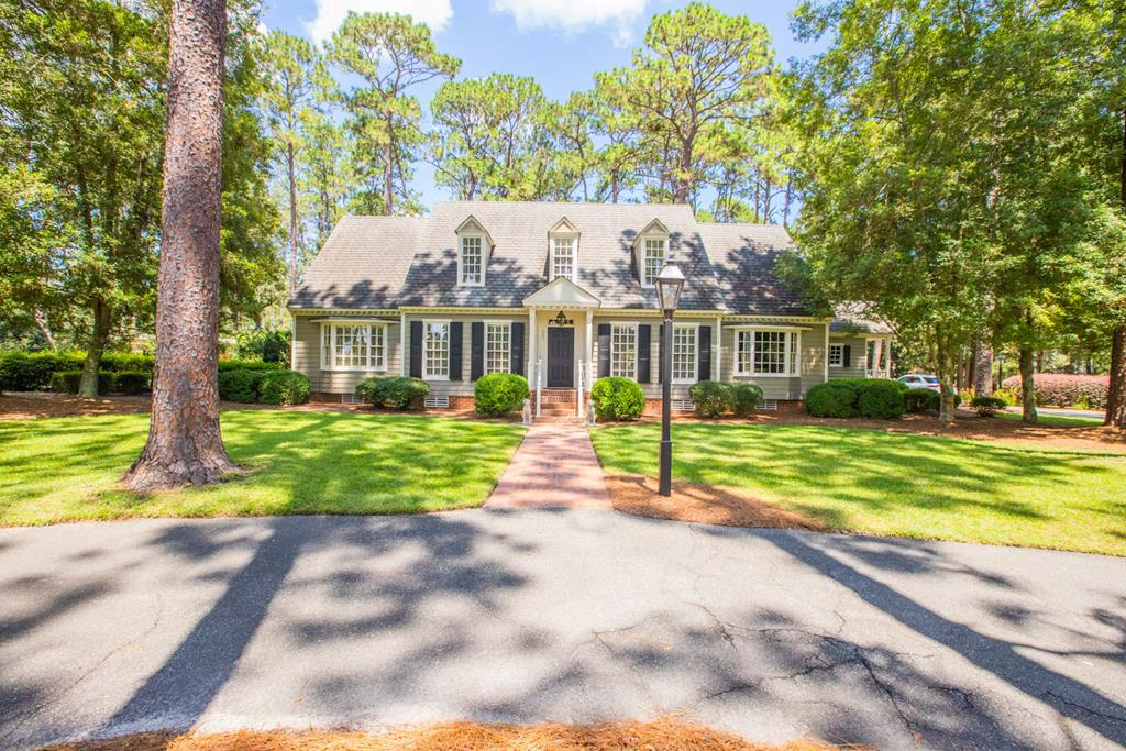Located one mile from the small town of Boston, GA, this beautiful home is surrounded by 5 wooded acres of old growth pine, ancient live oaks, and stately magnolias. Charm immediately greets as you pass the Chippendale entrance gates. A brick walkway and porch welcome you to the front door. The 3635 square foot home is classically designed with beaded board siding, wood shutters, large bay windows, and dentil molding.  Within its 1 1/2 stories are 4 bedrooms and 3.5 baths.  Throughout the first floor are stunning wide plank, antique heart pine floors, complimented by travertine stone flooring in the sunporch and mudroom. The kitchen was designed by local Thomasville architect Stanley Smith and boasts beautiful custom cabinetry, granite countertops, marble backsplash, island, two pantries, two dishwashers, ovens, and warming drawer. The family room has horizontal beaded wood paneling, a custom mantel, and a wood burning fireplace. Also on the first floor is a dining room, living room, guest bedroom, 1.5 baths, and office. The mudroom features a hunter's closet with gun cabinet, and custom pine hunt board containing a hammered copper sink. Upstairs, the master suite has two 8 foot closets, a large walk-in closet/dressing room, and his and her vanities. Additionally, there are two other bedrooms, another full bath, a bonus room, generous storage space, whole house wi-fi, and monitored security system. Surrounded by a picket fence is a 38'x17' marcite, saltwater, heated pool with pergola and adjacent bath and dressing area. The expansive brick patio, complimented by an arbor and swing and a fully prepped outdoor kitchen, is great for family gatherings and entertaining. Inside and out, this house is full of charm and is minutes from downtown Boston and Ag Pro, 12 miles from Thomasville, 31 miles from Valdosta, and 45 miles from Tallahassee, FL.  Please call listing agent to schedule a showing of this must see home!